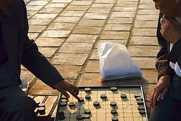 Two men playing a board game, Hanoi, Vietnam