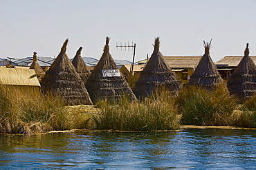 Huts in a village at the waterfront, Lake Titicaca, Uros Floating Islands, Puno, Peru