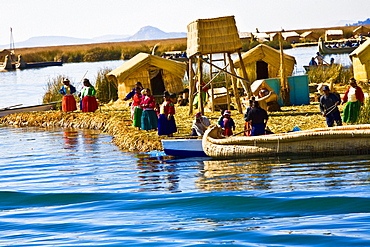 Group of people at a lakeside, Lake Titicaca, Uros Floating Islands, Puno, Peru