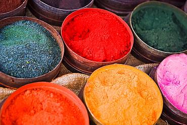 Close-up of various powder paints at a market stall, Pisaq, Cuzco, Peru