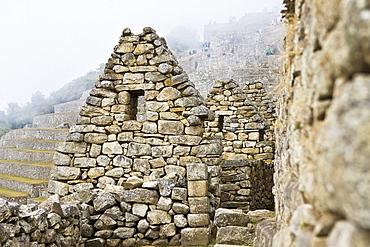 Old ruins of stone structures, Machu Picchu, Cusco Region, Peru