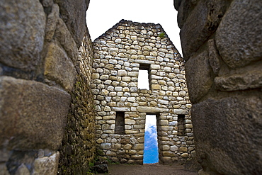 Low angle view of the old ruins, Aguas Calientes, Mt Huayna Picchu, Machu Picchu, Cusco Region, Peru