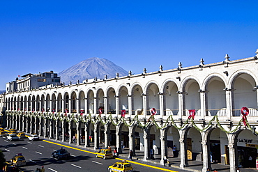 High angle view of cars moving on a road in front of a palace, Plaza-de-Armas, Arequipa, Peru
