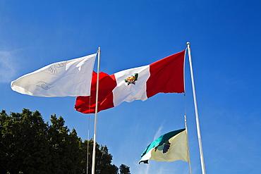 Low angle view of flags fluttering, Plaza-De-Armas, Pisco, Ica Region, Peru