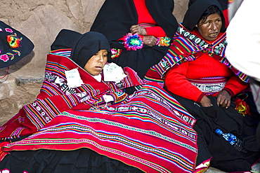 Mature woman sitting with a young woman at a wedding ceremony, Taquile Island, Lake Titicaca, Puno, Peru