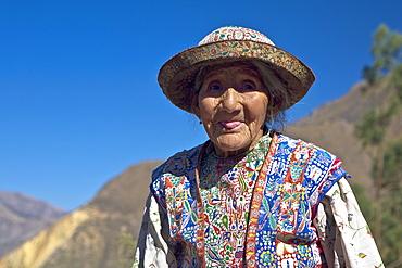 Portrait of a senior woman sticking her tongue out, Coshnirua, Peru