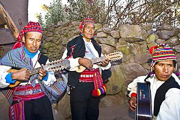 Three guitarists performing, Lake Titicaca, Taquile Island, Puno, Peru