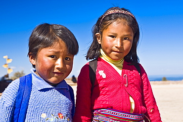 Portrait of a girl with a boy, Taquile Island, Lake Titicaca, Puno, Peru