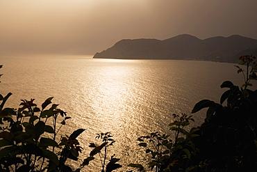 Silhouette of a mountain at the seaside, Italian Riviera, Cinque Terre National Park, Mar Ligure, Cinque Terre, La Spezia, Liguria, Italy