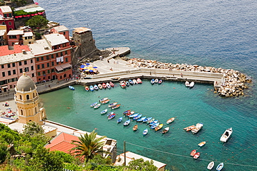 High angle view of boats in the sea, Church of Santa Margherita d'Antiochia, Doria Castle, Italian Riviera, Cinque Terre National Park, Vernazza, La Spezia, Liguria, Italy