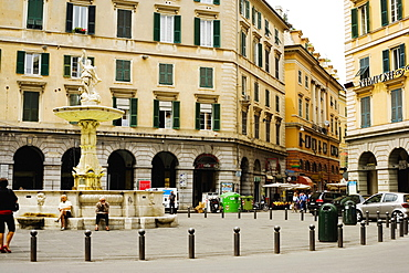 Fountain in front of buildings, Piazza Colombo, Genoa, Liguria, Italy