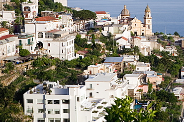 High angle view of buildings in a town with a church in the background, Parrocchiale di San Gennaro, Amalfi Coast, Maiori, Salerno, Campania, Italy