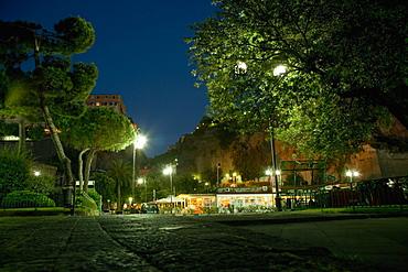 Lampposts at roadside lit up at night, Piazza Marinai d'Italia, Sorrento, Sorrentine Peninsula, Naples Province, Campania, Italy