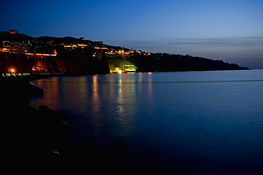 Buildings lit up at the waterfront, Bay of Naples, Sorrento, Sorrentine Peninsula, Naples Province, Campania, Italy