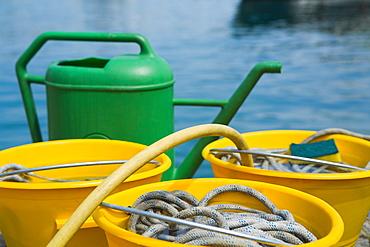 Close-up of buckets with a watering can, Italian Riviera, Santa Margherita Ligure, Genoa, Liguria, Italy