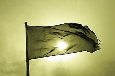 Low angle view of a flag fluttering, Italian Riviera, Cinque Terre National Park, Mar Ligure, Cinque Terre, La Spezia, Liguria, Italy