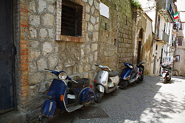 Motor scooters parked in front of buildings, Sorrento, Sorrentine Peninsula, Naples Province, Campania, Italy