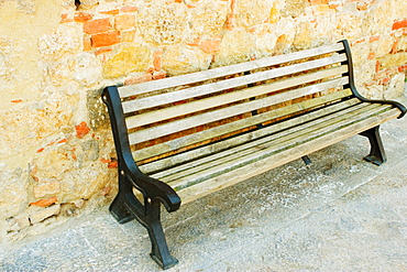 Empty bench in front of a wall, Monteriggioni, Siena Province, Tuscany, Italy