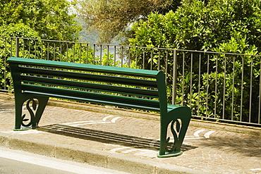 Bench on the sidewalk, Via Padre Reginaldo Giuliani, Sorrento, Sorrentine Peninsula, Naples Province, Campania, Italy