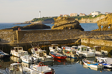 Boats moored at a port, Port Des Pecheurs, Baie De Biarritz, Phare De Biarritz, Biarritz, France