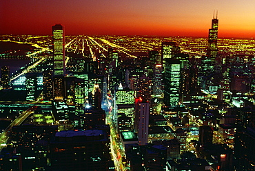 Aerial view of a city lit up at night, John Hancock Building, Chicago, Illinois, USA