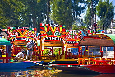 Two men on a trajineras boat, Xochimilco Gardens, Mexico City, Mexico