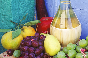 Close-up of a bottle with fruit on the table