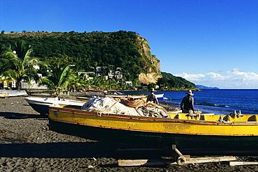 Rear view of fishermen wearing straw hats standing near fishing boats, Martinique