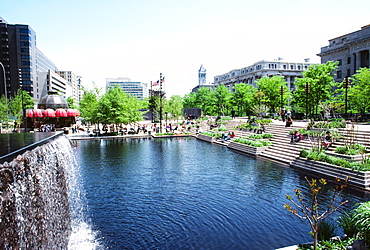 Man made pond with buildings in the background, Washington DC, USA