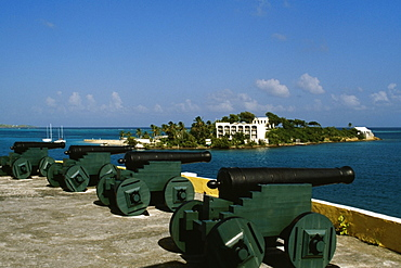 View of cannons with a fort seen in the background, Christiansvaern fort, St. Croix, U.S. Virgin Islands