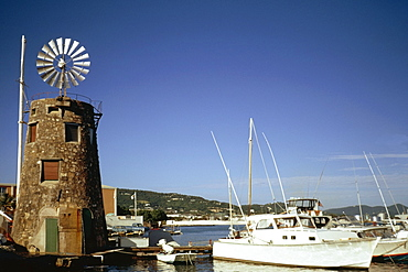 View of boats at a harbor near a windmill, St. Croix, Virgin Islands