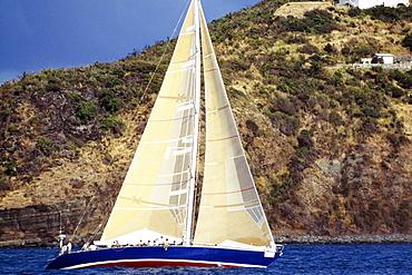 A sailboat is seen participating in the Heiniken Regatta on St. Maarten.