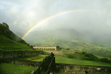 View of a beautiful rainbow arched amidst vast and lush meadows, St. Kitts, Leeward Islands, Caribbean