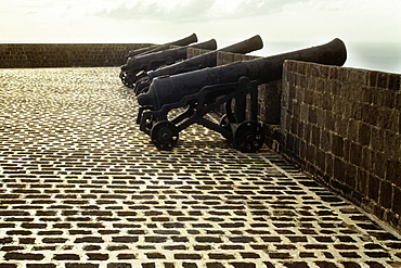 A series of cannons on an old and historic fort, St. Kitts, Leeward Islands, Caribbean