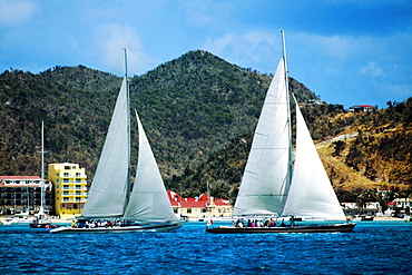 Two sailboats are seen participating in the Heiniken Regatta on the Dutch side of the island of St. Maarten in the Caribbean