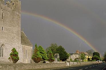 Rainbow over buildings, Adare, Republic of Ireland