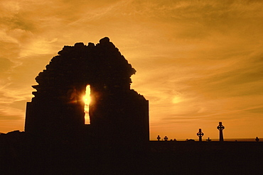 Celtic crosses at sunset in a cemetery, County Clare, Republic of Ireland