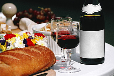 Close up of Burgundy wine and French bread arranged on a table, France