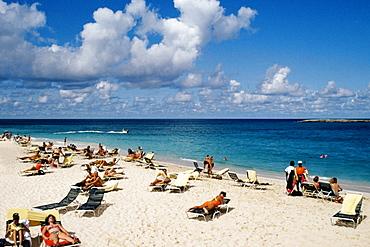 Large group of tourists sunbathing on a beach, Paradise Island, Bahamas