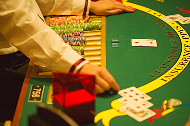 High angle view of a casino worker playing blackjack, Las Vegas, Nevada, USA