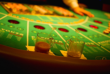 Close-up of a person's hand on a gaming table, Las Vegas, Nevada, USA