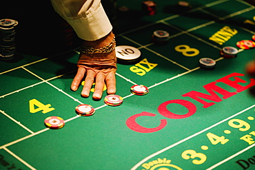 High angle view of a man's hand on a gaming table in a casino, Las Vegas, Nevada, USA