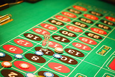 High angle view of a win marker and gambling chips on a roulette table, Las Vegas, Nevada, USA