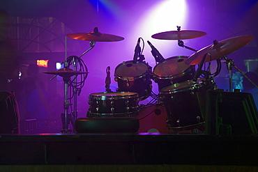 Spotlight on a drum kit in a nightclub, New Orleans, Louisiana, USA