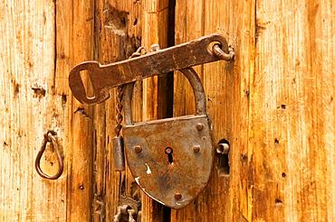Close-up of the broken lock on a door