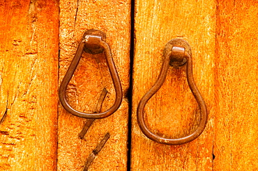 Close-up of a pair of doorknockers on a door