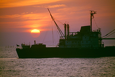 Freighter at sunset in Ho Chi Minh City (formerly Saigon) Vietnam