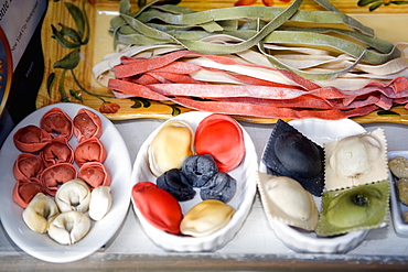 Close-up of uncooked assorted pastas and dumplings in trays