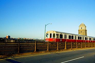 Train moving on tracks along a road, Longfellow Bridge, Boston, Massachusetts, USA