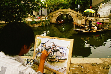 Rear view of a man painting, Tongli, Jiangsu Province, China